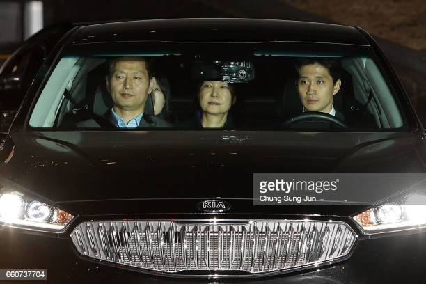 Ousted South Korean President Park Geunhye leaves the prosecutors' office as she is transferred to a detention house on March 31 2017 in Seoul South...
