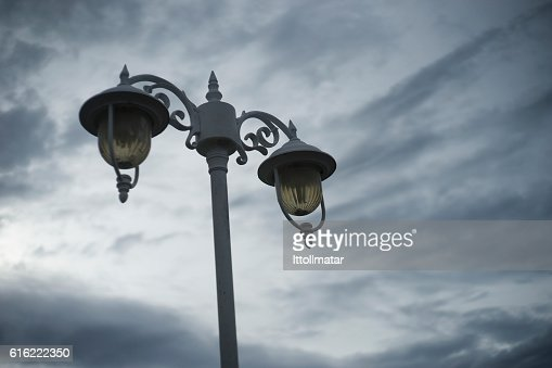 out door vintage ancient lamp with cloudy sky background : Bildbanksbilder
