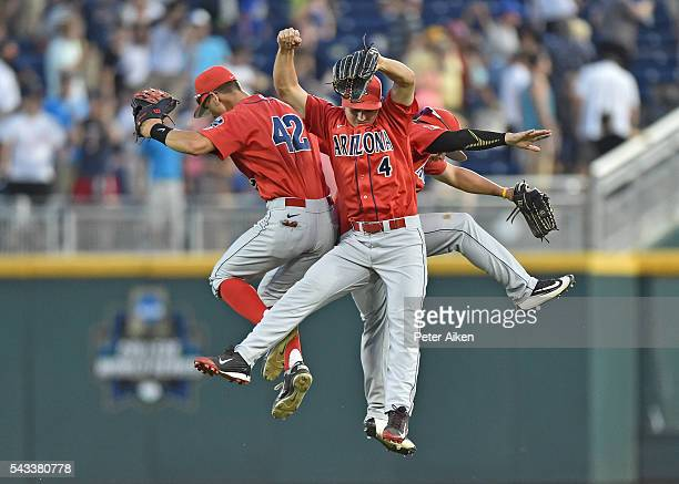 Out fielders Justin Behnke Jared Oliva and Zach Gibbons of the Arizona Wildcats celebrate after beating the Coastal Carolina Chanticleers 30 in game...