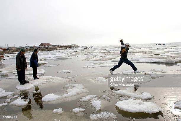 Out late on a Friday night teenage Inupiat Eskimos go icehoping on the Chukchi Sea at 1 am one of the rare distractions in Shishmaref June 10 2005 in...