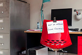 Employee leaves note on back of office chair: 'Out of Office. Gone Fishing!'
