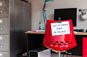 Employee leaves note on back of office chair: 'Out of Office. Gone on Holiday!'