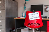Employee leaves note on back of office chair: 'Out of Office. Gone on Vacation!'
