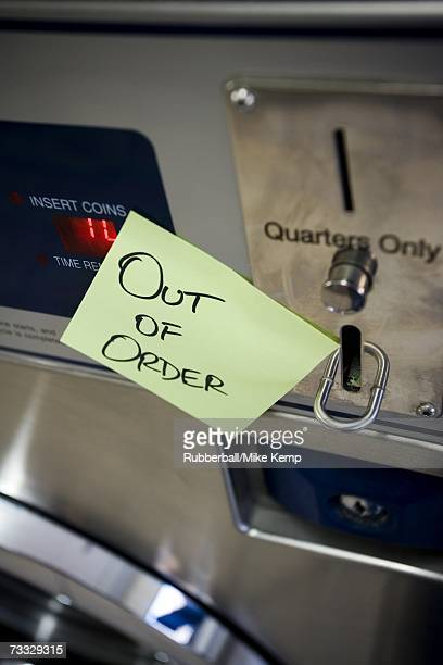 Out of order sign on Laundromat machine
