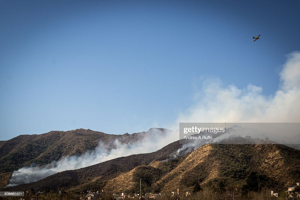 outbreak of fire in the balcony area of ??the commune san roque, argentina, working 13 fire crews and 2 firefighting planes