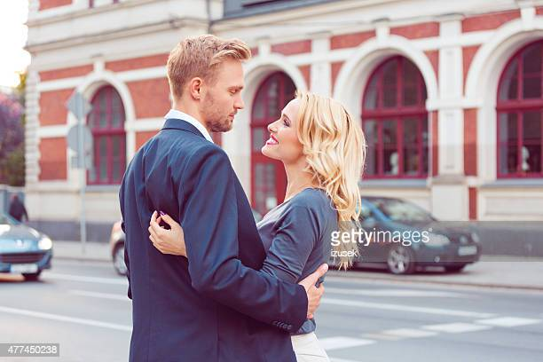Outddor portrait of affectionate couple on a street