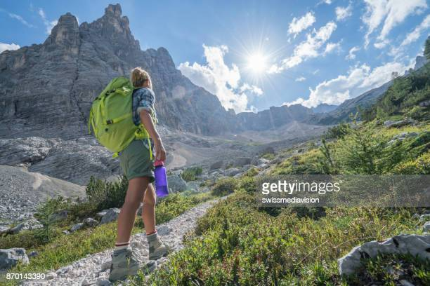 Outdoor activities, people enjoying hiking in Summer, mountain landscape at the Dolomites, Italy