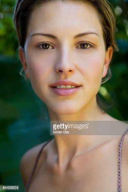 Outdoor beauty portrait with green background