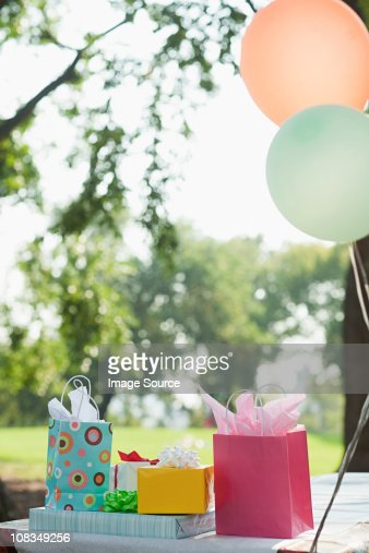 outdoor birthday party with balloons stock photo getty