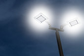 LED outdoor car park flood light working on night, saving energy.
