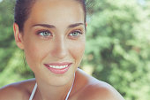 Outdoor, close-up, beauty portrait of a beautiful freckled woman