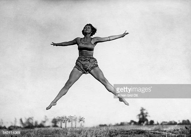 Outdoor gymnastics dancing Rhythmic and gymnastic exercises by members of the Hertha Feist School for Dance and Gymnastics in Berlin a woman jump...