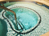 Outdoor Jacuzzi Pool with Fresh Blue Water for Massage and Spa.
