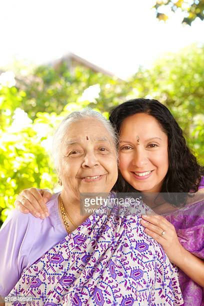 Outdoor Indian Family Portrait—Mother and Daughter Dressed in Saris