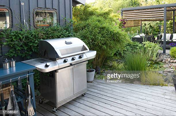 Outdoor kitchen with a stainless-steel gas grill