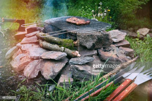 Outdoor life, grilling a steak on the campfire