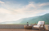 Outdoor living with mountain view 3d rendering image.Decorate with wood furniture There are wooden floor,stone wall and surrounding with nature and mountains