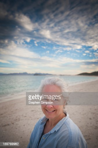 outdoor make-up less portrait at the beach : Stock Photo