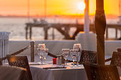 Close-up of outdoor place setting during sunset at waterfront