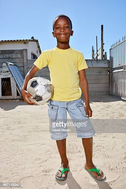 Outdoor portrait of boy with a ball