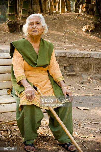 Outdoor portrait of cheerful senior Asian Indian woman lady female