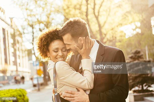 Outdoor portrait of flirting elegant couple