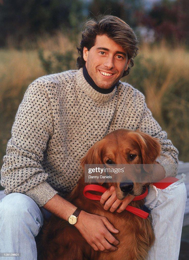 Outdoor portrait of man sitting w/ dog : Stock Photo