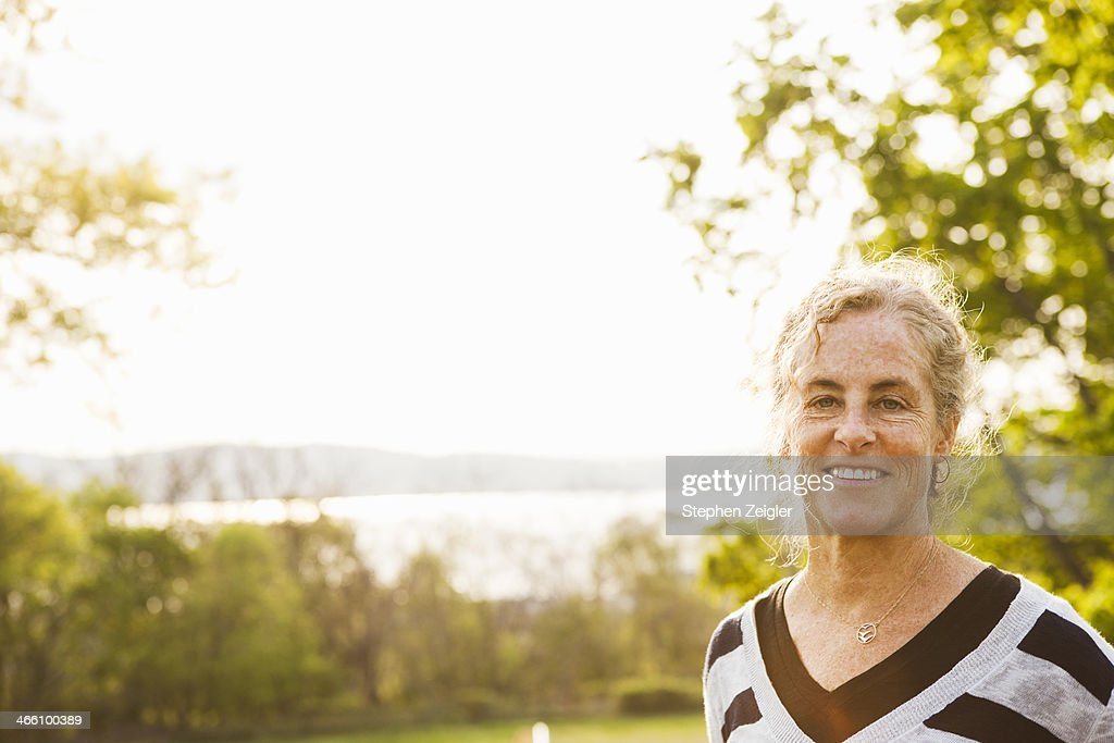 Outdoor portrait of smiling mature woman : Stock Photo