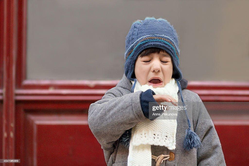Outdoor portrait of sneezing boy : Foto de stock