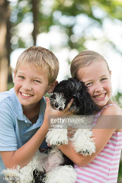 Outdoor Portrait of Young Children and Pet Dog