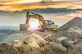 Outdoor quarry with heavy machinery or road construction