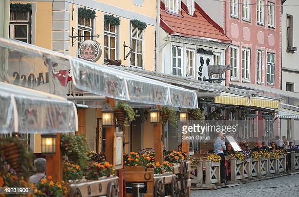 Outdoor restaurants beckon tourists in the old city center on May 19 2014 in Riga Latvia Founded in 1201 the city is a former member of the Hanseatic...