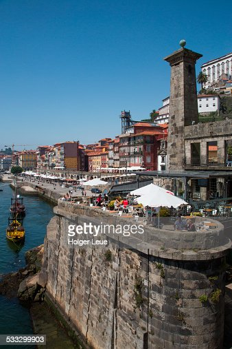 Outdoor seating at cafes alongside Douro river
