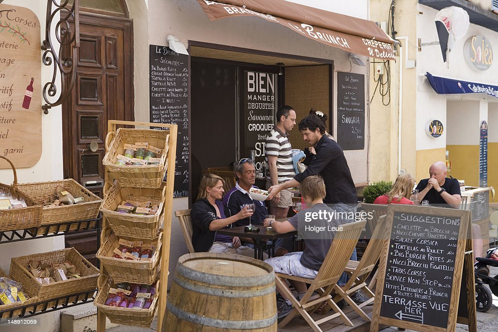 Outdoor seating at restaurant in central city. : Stock Photo