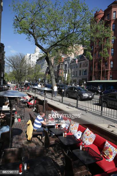 Outdoor seating is pictured at Met Back Bay on Newbury Street in Boston on May 10 2017