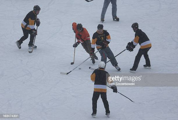 Outdoor shinny hockey action during the 4th Annual Lake Louise Pond Hockey Classic on the frozen surface of Lake Louise on March 2 2013 in Lake...