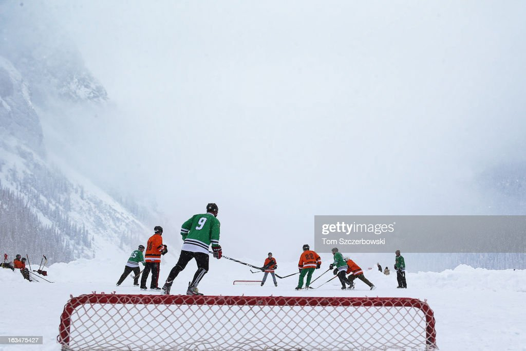 Outdoor shinny hockey action during the 4th Annual Lake Louise Pond Hockey Classic on the frozen surface of Lake Louise on March 2, 2013 in Lake Louise, Alberta, Canada.