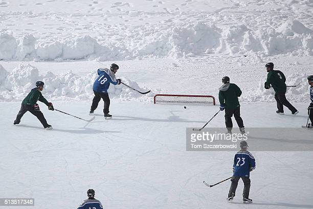 Outdoor shinny hockey action during the 7th Annual Lake Louise Pond Hockey Classic on the frozen surface of Lake Louise on February 27 2016 in Lake...
