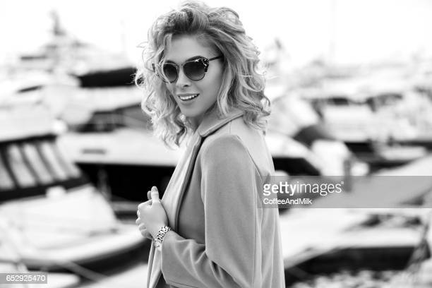 Outdoor shot of young beautiful woman on a pier