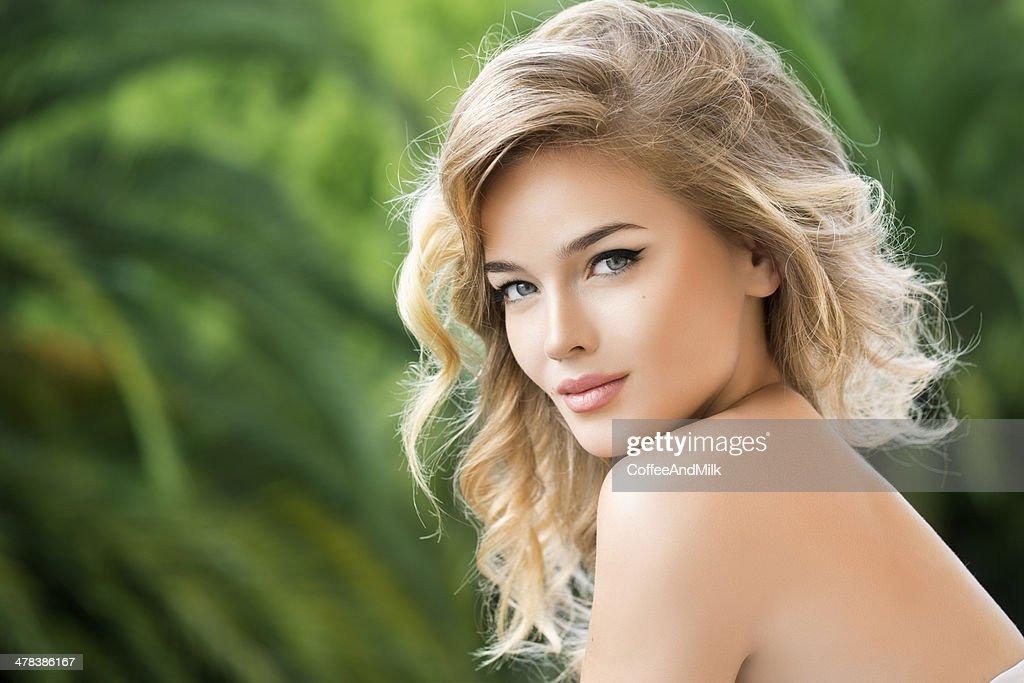Outdoor shot of young beautiful woman.