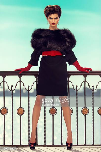 Outdoor shot of young beautiful woman wearing clothes haute couture