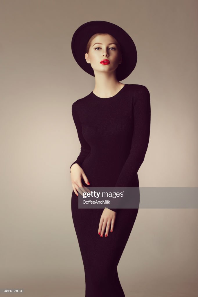 Outdoor shot of young beautiful woman wearing retro hat