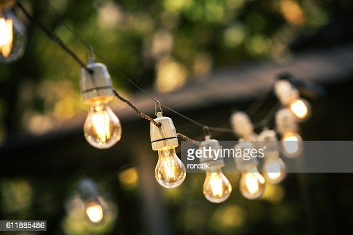 outdoor string lights hanging on a line in backyard : Stock Photo