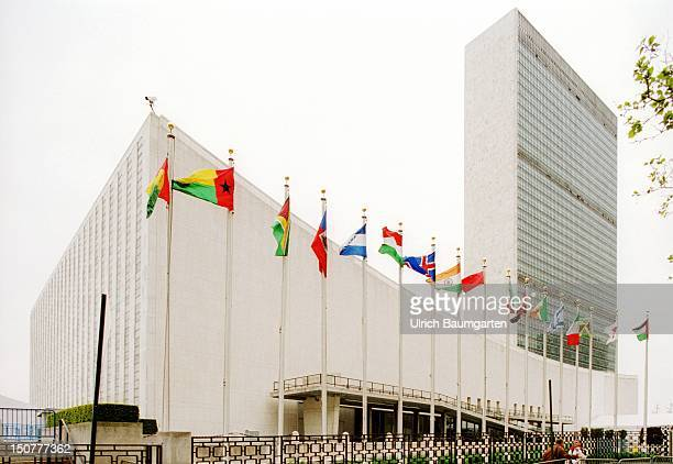 Outdoor view head office of the United Nations with flags in the front