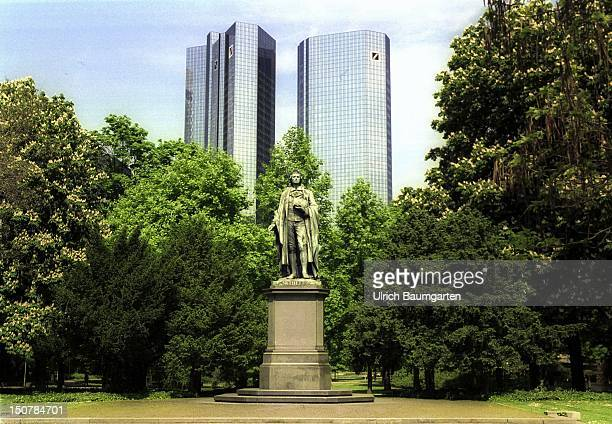 Outdoor view of the headquarters of the Deutsche Bank AG in Frankfurt in the foreground the Schiller monument