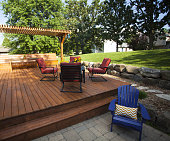 Outdoor stained wooden deck summer view.
