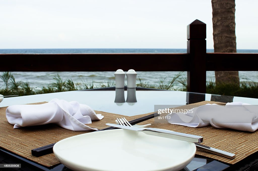 Outdoors decorated table with a sea view : Stock Photo