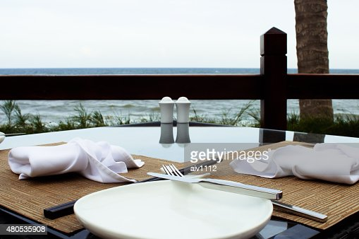 Outdoors decorated table with a sea view : Stockfoto