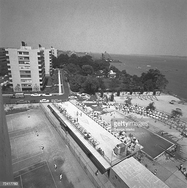 Outdoors swimming pool at seashore , (B&W), elevated view