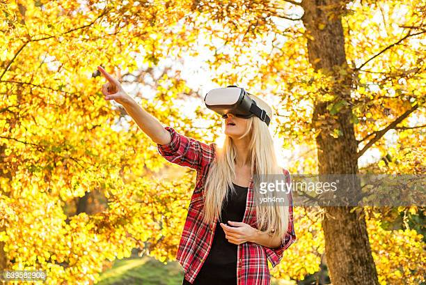 Outdoors with Vr headset in spring